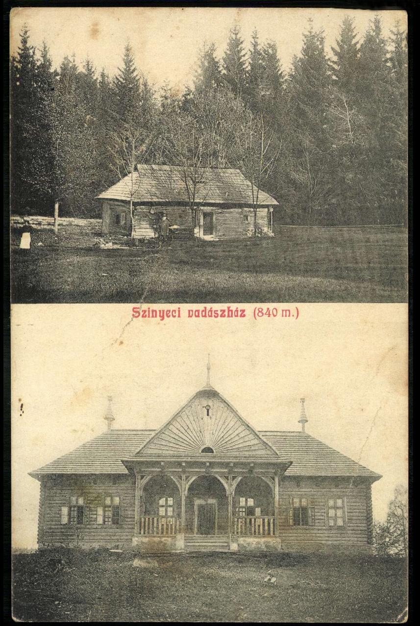 Lovecká chata s poľovníkom v popredí